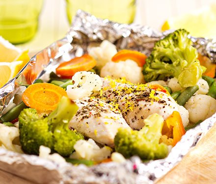 Chicken and veggies wrapped in foil