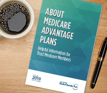 "A booklet entitled ""About Medicare Advantage Plans"" lays ontop a desk next to a cup of coffee and pen."